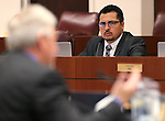 Nevada Assemblyman Edgar Flores, D-Las Vegas, works in committee at the Legislative Building in Carson City, Nev., on Wednesday, April 22, 2015. <br /> Photo by Cathleen Allison