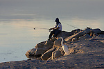 great egret and fisherman at the Salton Sea
