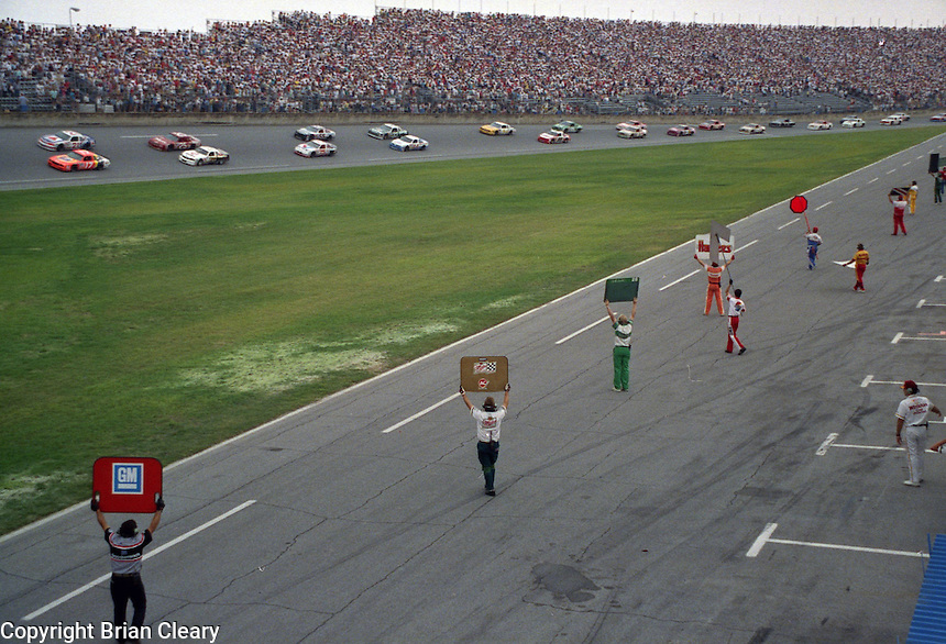 pre race pace lap pit crewmwn sign board  Pepsi Firecracker 400 at Daytona International Speedway in Daytona Beach, FL in July 1988. (Photo by Brian Cleary/www.bcpix.com)