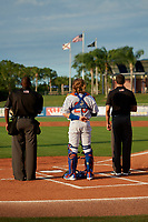 St. Lucie Mets catcher Nick Meyer (26) during the national anthem with umpires Dexter Kelley (left) and John Benken (right) before a Florida State League game against the Florida Fire Frogs on April 12, 2019 at First Data Field in St. Lucie, Florida.  Florida defeated St. Lucie 10-7.  (Mike Janes/Four Seam Images)