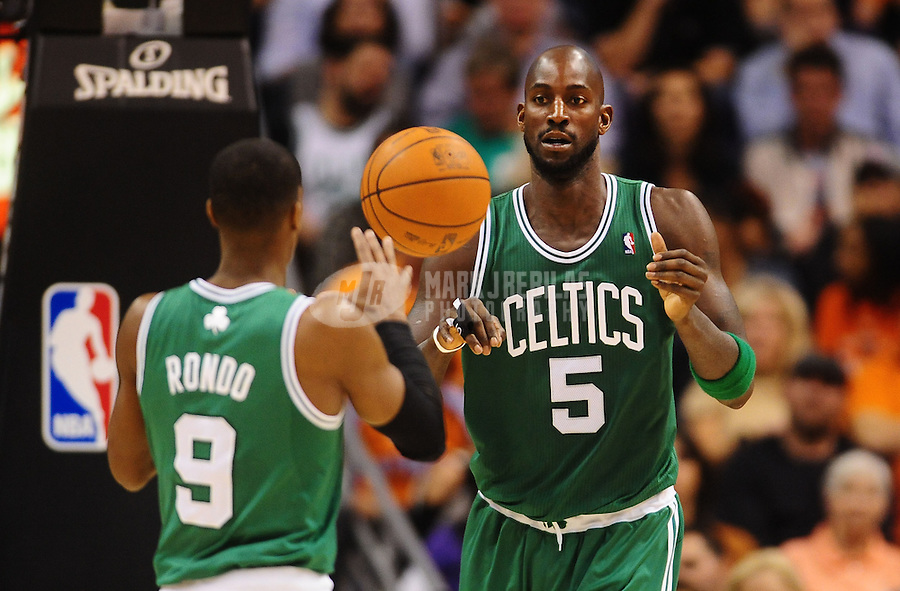 Jan. 28, 2011; Phoenix, AZ, USA; Boston Celtics forward (5) Kevin Garnett passes the ball to guard Rajon Rondo against the Phoenix Suns at the US Airways Center. Mandatory Credit: Mark J. Rebilas-