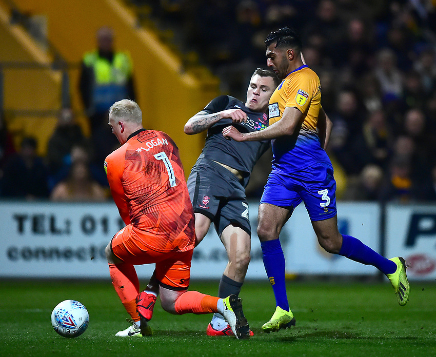 Lincoln City's Harry Anderson is fouled by Mansfield Town's Conrad Logan<br /> <br /> Photographer Andrew Vaughan/CameraSport<br /> <br /> The EFL Sky Bet League Two - Mansfield Town v Lincoln City - Monday 18th March 2019 - Field Mill - Mansfield<br /> <br /> World Copyright © 2019 CameraSport. All rights reserved. 43 Linden Ave. Countesthorpe. Leicester. England. LE8 5PG - Tel: +44 (0) 116 277 4147 - admin@camerasport.com - www.camerasport.com