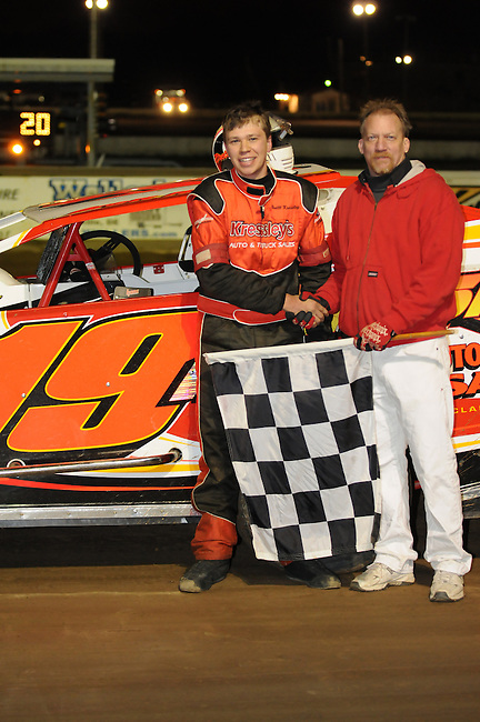 Brett Kressley celebrates in victory lane after winning the first crete sportsman race of the 2012 season at Bridgeport Speedway