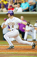 Jordy Snikeris #6 of the LSU Tigers follows through on his swing against the Wake Forest Demon Deacons at Alex Box Stadium on February 19, 2011 in Baton Rouge, Louisiana.  The Tigers defeated the Demon Deacons 4-3.  Photo by Brian Westerholt / Four Seam Images