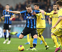 Calcio, Serie A: Inter Milano - Hellas Verona, Giuseppe Meazza stadium, November 9, 2019.<br /> Inter's Milan Skriniar (l) in action with Hellas Verona's Matteo Pessina (r) during the Italian Serie A football match between Inter and Hellas Verona at Giuseppe Meazza (San Siro) stadium, on November 9, 2019.<br /> UPDATE IMAGES PRESS/Isabella Bonotto