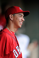 Designated hitter Mauricio Dubon (10) of the Greenville Drive is pictured in the dugout before a game against the Augusta GreenJackets on Thursday, June 11, 2015, at Fluor Field at the West End in Greenville, South Carolina. Dubon is the No. 23 prospect of the Boston Red Sox, according to Baseball America. Greenville won, 10-1. (Tom Priddy/Four Seam Images)