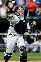 Chicago White Sox catcher Tyler Flowers #17 throws to first to record the final out during a game against the Kansas City Royals at U.S. Cellular Field on August 14, 2011 in Chicago, Illinois.  Chicago defeated Kansas City 6-2.  (Mike Janes/Four Seam Images)