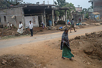 People walk on a street in village Gorikothapally, Telangana, Indiia, on Friday, February 8, 2019. Photographer: Suzanne Lee for Safe Water Network