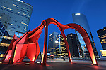 The night view of the skyscrapers and the red arches of modern sculpture ´Grand stabile rouge´ by Alexandre Calder in La Défense. Paris. France