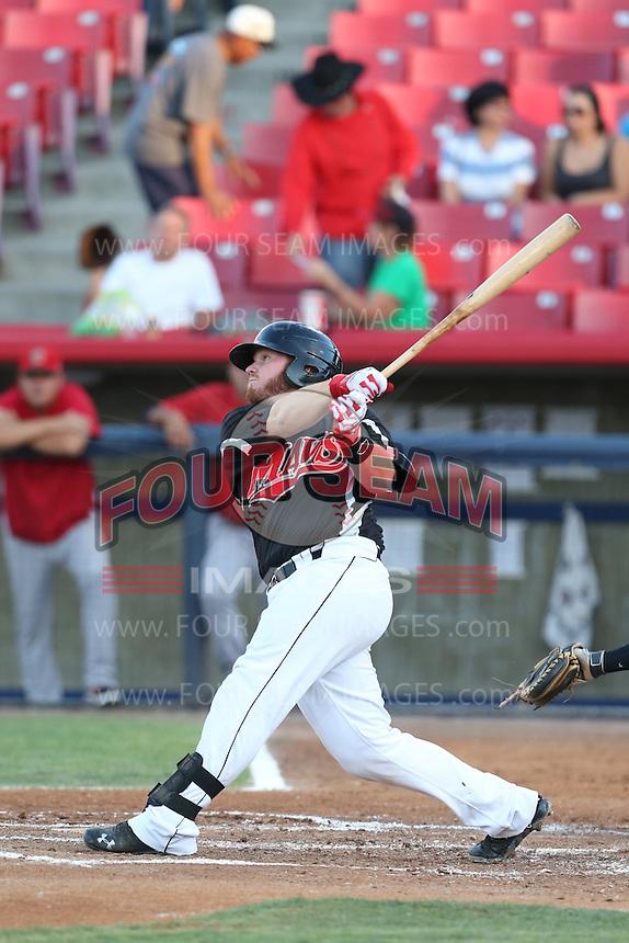 Tyler Marlette #30 of the Visalia Rawhide bats against the High Desert Mavericks at Heritage Field on July 19, 2014 in Adelanto, California. Visalia defeated High Desert, 10-9. (Larry Goren/Four Seam Images)