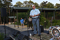 NWA Democrat-Gazette/FLIP PUTTHOFF <br /> SHELTER FOR LEARNING<br /> Grady Spann, director of Arkansas State Parks, speaks Saturday June 10 2017 during an unveiling of the design for a new  education pavilion to be built near the visitor center at Hobbs State Park-Conservation Area. Friends of Hobbs hosted a gala Saturday evening to unveil the design of the pavilion that will serve as an outdoor classroom and a covered outdoor venue for park events. Construction will begin this summer, said Rich Brya, board member with Friends of Hobbs. The $500,000 project is funded by Friends of Hobbs with a matching grant from Arkansas State Parks, Brya said. Location of the pavilion is in the picnic area just east of the visitor center.The event featured a concert by National Park Radio, food, and prize drawings.