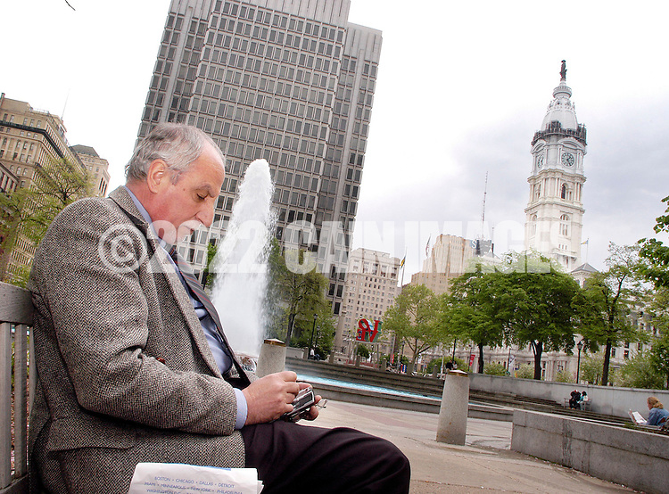 PHILADELPHIA - MAY 2:  Ennio Brugnolo of Philadelphia, Pennsylvania uses a PDA wireless device to connect to the internet at Love Park, part of the Wireless Philadelphia project May 2, 2005 in Philadelphia, Pennsylvania. Philadelphia's wireless internet plam is to have low-cost wifi internet access available throughout the city. (Photo by William Thomas Cain)