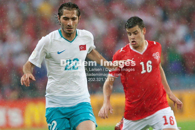 BASEL, SWITZERLAND - JUNE 11:  Hamit Altintop of Turkey (22) and Tranquillo Barnetta of Switzerland (16) in action during the UEFA Euro 2008 Group A match at St. Jakob Park on June 11, 2008 in Basel, Switzerland. Editorial use only.  Commercial use prohibited.  (Photograph by Jonathan P. Larsen)