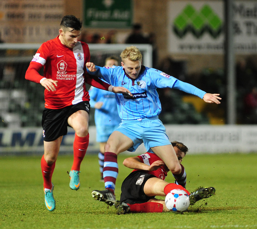 Gateshead's Jamie Chandler is tackled by Lincoln City's Todd Jordan <br /> <br /> (Photo by Chris Vaughan/CameraSport)<br /> <br /> Football - The Skrill Premier - Lincoln City v Gateshead - Tuesday 10th December 2013 - Gelder Group Sincil Bank Stadium - Lincoln<br /> <br /> &copy; CameraSport - 43 Linden Ave. Countesthorpe. Leicester. England. LE8 5PG - Tel: +44 (0) 116 277 4147 - admin@camerasport.com - www.camerasport.com