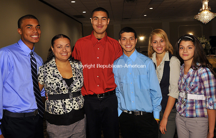 WATERBURY, CT 12 OCTOBER 2011--101211JS15---Outstanding Achievement Award recipient Jose Negron, third from left, with his family, Alex Echevarria, 17, Evelyn Negron, Ramon Quinones, 14, Stephanie Echevarria, 15 and Maria Quinones, 12, at the annual Waterbury Youth Services Champions of Youth Fall Gala at the Ponte Club in Waterbury. <br /> Jim Shannon Republican-American