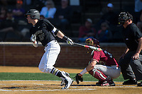 Keegan Maronpot (13) of the Wake Forest Demon Deacons follows through on his swing against the Florida State Seminoles at David F. Couch Ballpark on April 16, 2016 in Winston-Salem, North Carolina.  The Seminoles defeated the Demon Deacons 13-8.  (Brian Westerholt/Four Seam Images)