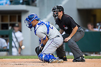 Durham Bulls catcher Luke Maile (26) blocks a pitch in the dirt as home plate umpire Jansen Visconti looks on during the game against the Charlotte Knights at BB&T BallPark on July 22, 2015 in Charlotte, North Carolina.  The Knights defeated the Bulls 6-4.  (Brian Westerholt/Four Seam Images)