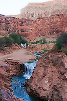 8/2/09 Havasupai-- Water from Havasu Creek flows over Fifty Foot Falls, top, and Rock Falls, bottom. A flash flood in August of 2008 made Fifty Foot Falls larger and created Rock Falls.  (Pat Shannahan/ The Arizona Republic)