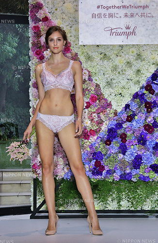"Models present fashions during the ""Florale by Triumph Lingerie Collection"" launch event at the Aoyama Geihinkan in Tokyo, Japan on September 27, 2018."