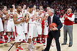 Wisconsin Badgers seniors Jordan Taylor (11) and Rob Wilson (11) present Head Coach Bo Ryan with a game ball for tying Wisconsin's all-time record as a basketball coach after a Big Ten Conference NCAA college basketball game against the Illinois Fighting Illini on Sunday, March 4, 2012 in Madison, Wisconsin. The Badgers won 70-56. (Photo by David Stluka)