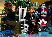 First lady Laura Bush introduces her Scottish Terrier Barney Bush at the Children's National Medical Center during the annual Christmas program and visit to the hospital in Washington, DC on December 12, 2003.  Mrs. Bush is accompanied by Stephanie Chapman.<br />