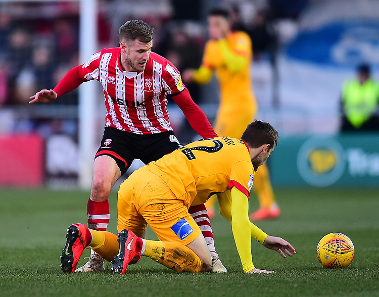 Northampton Town's Timi Elsnik battles with  Lincoln City's Michael O'Connor<br /> <br /> Photographer Andrew Vaughan/CameraSport<br /> <br /> The EFL Sky Bet League Two - Lincoln City v Northampton Town - Saturday 9th February 2019 - Sincil Bank - Lincoln<br /> <br /> World Copyright © 2019 CameraSport. All rights reserved. 43 Linden Ave. Countesthorpe. Leicester. England. LE8 5PG - Tel: +44 (0) 116 277 4147 - admin@camerasport.com - www.camerasport.com