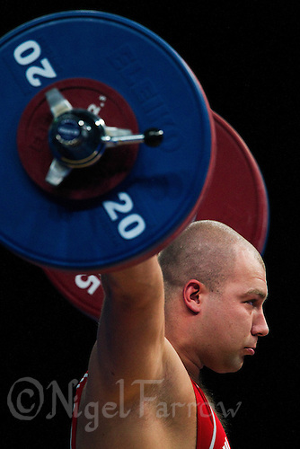11 DEC 2011 - LONDON, GBR - Bartlomiej Bonk (POL) lifts during the men's +105kg category Snatch during the London International Weightlifting Invitational and 2012 Olympic Games test event held at the ExCel Exhibition Centre in London, Great Britain .(PHOTO (C) NIGEL FARROW)