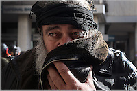 Pictured: A farmer covers his mouth to avoid tear gas Friday 12 February 2016<br /> Re: Violent clashes between farmers and riot police outside the Ministry of Agricultural Development in Athens, Greece. The farmers travelled from Crete to protest against pension and welfrae reforms proposed by the Greek government,