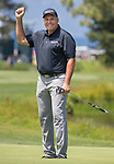 Mark Rypien smiles after sinking a putt during the American Century Championship at Edgewood Tahoe Golf Course in Stateline, Nevada, Saturday, July 14, 2018.