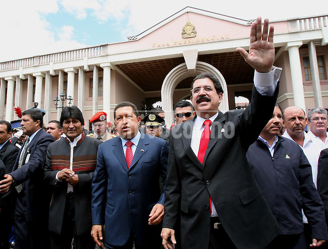 President of Honduras, Manuel Zelaya waves while walking with presidents of  Venezuela Hugo Chavez  and Bolivia, Evo Morales, in the ceremony incorporating Honduras to the ALBA, the Bolivarian Group of Countries.