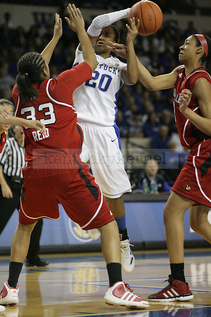 UK sophomore guard Meagan Conwright recieves pressure form Louisville defenders during the first half of UK Hoop's home game against Louisville at Memorial Coliseum in Lexington, Ky., Dec. 4, 2011. Photo by Brandon Goodwin