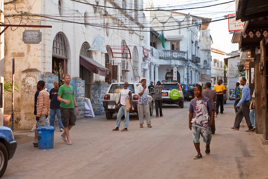 Zanzibar, Tanzania.  Kenyatta Street, Post Office on Left by the Internet Sign, Stone Town.