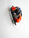 14 December 2007: Michelle Kelly, racing for Canada, exits the last turn and heads for the finish line during her first run of the FIBT World Cup Skeleton Competition at the Olympic Sports Complex on Mount Van Hoevenberg, at Lake Placid, New York, USA. ..Mandatory Photo Credit: Ed Wolfstein Photo