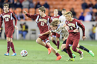 Houston, TX - Friday December 9, 2016: Hayden Partain (21) of the Wake Forest Demon Deacons battles for the ball with Karsten Hanlin (17) and Andre Shinyashiki (9) of the Denver Pioneers at the NCAA Men's Soccer Semifinals at BBVA Compass Stadium in Houston Texas.