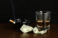 """The """"Last Dollar"""" portrays the end a long night at a bar with a glass of whiskey and a cigarette to end the night. Taken at my studio in Belton, Missouri on November 5, 2007"""