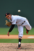 Starting pitcher Austin Cox (14) of the Mercer Bears delivers a pitch in a game against the VMI Keydets as part of the Southern Conference Championship series on Wednesday, May 24, 2017, at Fluor Field at the West End in Greenville, South Carolina. Mercer won, 11-6. (Tom Priddy/Four Seam Images)