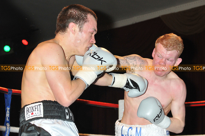 Ian Bailey (grey shorts) defeats Lee Martin in a Featherweight boxing contest at the Civic Hall, Grays, Essex, promoted by Carl Greaves - 15/03/14 - MANDATORY CREDIT: Philip Sharkey/TGSPHOTO - Self billing applies where appropriate - 0845 094 6026 - contact@tgsphoto.co.uk - NO UNPAID USE