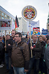 A man holding a banner during a demonstration by the Alternative für Deutschland (AfD) political party through the centre of Berlin. Around 5000 supporters of the AfD took part in the march and rally calling on German Chancellor Angela Merkel to halt the influx of refugees into the country. Around one million refugees from the Middle East and north Africa arrived in Germany during 2015, 50,000 of whom came to Berlin.