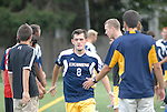 Lycoming College mens soccer team runs the gauntlet as they are introduced before a game.