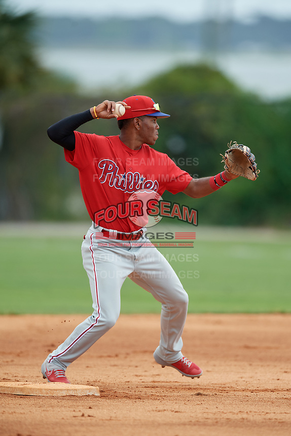 Philadelphia Phillies Luis Garcia (5) throws to first base during an Instructional League game against the Detroit Tigers on September 19, 2019 at Tigertown in Lakeland, Florida.  (Mike Janes/Four Seam Images)