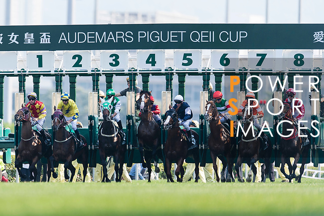 Jockeys compete the Audemars Piguet Queen Elizabeth II Cup horse race (2000m) at Sha Tin race course in Hong Kong on April 30, 2017 (Photo by Marcio Rodrigo Machado / Power Sport Images)