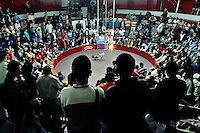Colombian spectators watch a cockfight in the arena of San Miguel, Bogota, Colombia, 7 April 2006. Gallera San Miguel is one of the most prestigious cockfight arenas in Colombia. Cockfight is a widely popular and legal sporting event in much of Latin America. People take advantage of cock's natural, strong will to fight against all males of the same species. Birds are specially bred to increase their aggression and stamina, they are given the best of food and care. The cocks are equipped with tortoise-shell made gaffs tied to the bird's leg. The fight is not intentionally to the death but it may result in the death of cocks very often because birds never stop fighting till they are dead.