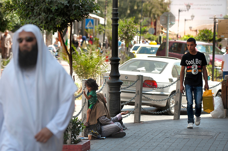 A woman begs for money in Ramallah, West Bank.