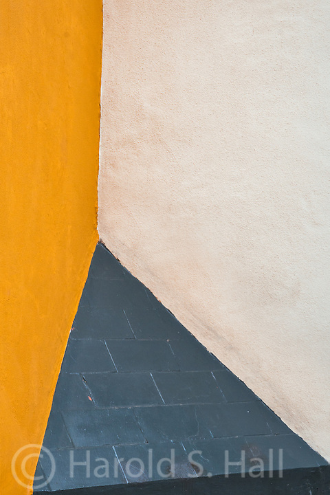 Walking down the narrow, twisting streets of Siville, Spain this intersection of various angles and colors appealed to me.  Clearly simply an abstract design. What originally appealed to me was a clay pipe and some other designs, but the photo got simplified to what you see here.