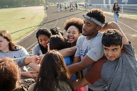 Second from left: Freshmen Armani Perkins, 14 (CQ), Jayla Wilkins (LAUGHING) ,14, (CQ) junior Tyreke Speight, 16, (CQ) and freshman Dylan Mendez, 14, (CQ) form a human knot and try to untangle themselves. The students are part of the Peer Group Connection mentor program at Greene Central Central High School, and met each other during a field day. Snow Hill, NC Friday, September 22, 2017. (Justin Cook for Education Week)