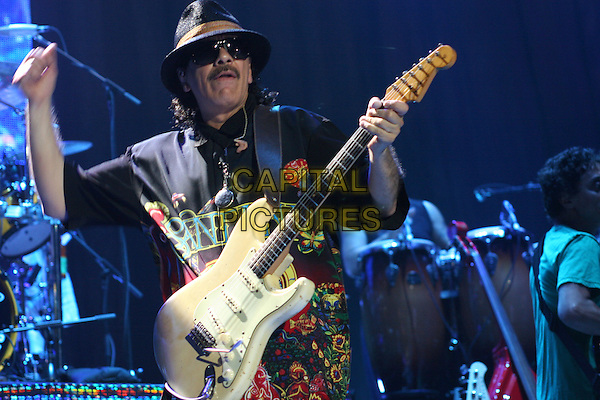 SANTANA.Performs in concert at Madison Square Garden in New York City..June 15th, 2005.stage live concert music gig performance half length guitar hat sunglasses shades.www.capitalpictures.com.sales@capitalpictures.com.©Capital Pictures