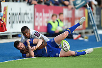 Barry Daly of Leinster Rugby is tackled into touch by Semesa Rokoduguni of Bath Rugby. Pre-season friendly match, between Leinster Rugby and Bath Rugby on August 25, 2017 at Donnybrook Stadium in Dublin, Republic of Ireland. Photo by: Patrick Khachfe / Onside Images