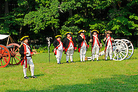 Captain Stephen Buckland's Artillery Company, the 3rd Connecticut Artillery Regiment, demonstrates colonial cannon practice during a Revolutionary War encampment and muster, at the Nathan Hale Homestead, Coventry, Connecticut, USA...
