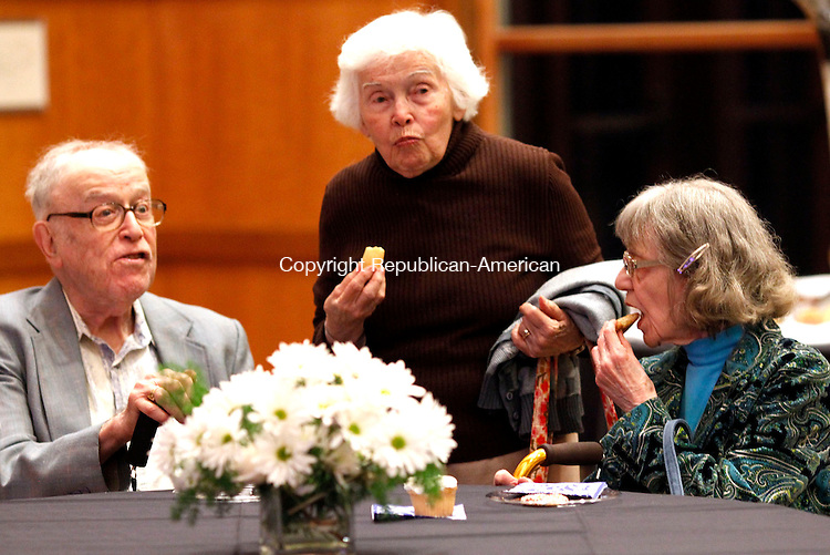 Southbury, CT- 21 June 2013-062113CM08-  Walter and Audrey, sitting, Borenbstein of Southbury enjoy refreshments with Doris Garber, of Southbury during a celebration at B'nai Israel in Southbury Friday night.  The event was held to celebrate the 10 year anniversary of the  building which shared by the Jewish Federation of Western CT, a non-profit who works to further the welfare and advancement of the Jewish community locally, overseas and in Israel and B'nai Israel, a Reform Jewish Congregation.   Rabbi Eric Polokoff led the Erev Shabbat Service, which was followed by refreshments.  Christopher Massa Republican-American
