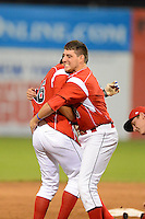 Batavia Muckdogs outfielder Austin Dean #3 hugs teammate Connor Burke #16 after a walk off hit during a game against the Mahoning Valley Scrappers on June 22, 2013 at Dwyer Stadium in Batavia, New York.  Batavia defeated Mahoning Valley 2-1 in ten innings.  (Mike Janes/Four Seam Images)